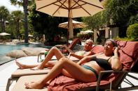 Newly-arrived tourists from Israel, Sigal Baram, 54, and Vered Bar-on, 53, enjoy at a swimming pool as Phuket reopens to overseas tourists, in Thailand
