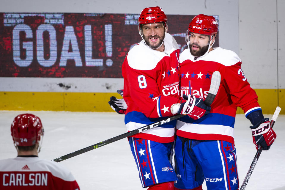 Washington Capitals left wing Alex Ovechkin (8), from Russia, is hugged by defenseman Radko Gudas (33), from Czech Republic, after scoring during the first period of an NHL hockey game against the New Jersey Devils, Thursday, Jan. 16, 2020, in Washington. (AP Photo/Al Drago)