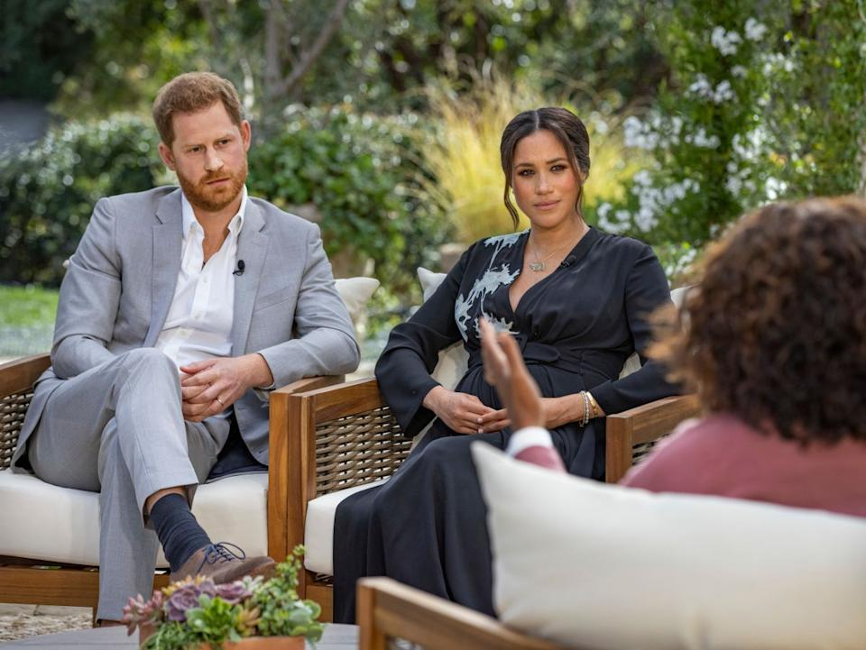 Prince Harry and Meghan, the Duke and Duchess of Sussex, in their interview with Oprah Winfrey, which airs on Sunday. (Photo: Joe Pugliese/CBS)