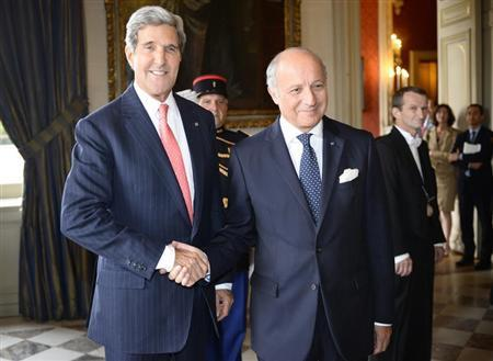 French Foreign Affairs Minister Fabius greets US Secretary of State Kerry at the ministry in Paris