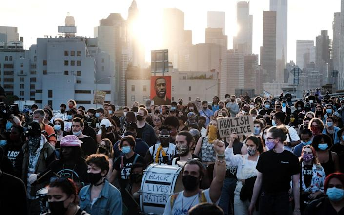 Black Lives Matter supporters and others march across the Brooklyn Bridge to honor George Floyd on the one year anniversary of his death on May 25, 2021 - Spencer Platt/Getty Images North America