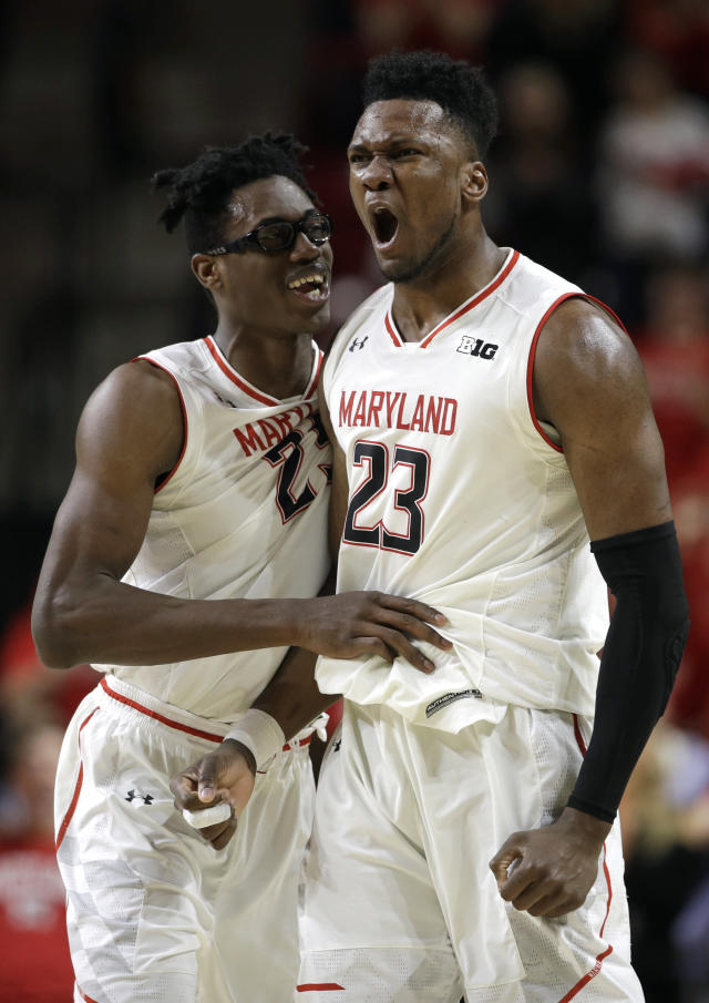 Maryland forwards Jalen Smith, left, and Bruno Fernando react after Purdue called a timeout following a Maryland run during the second half of an NCAA college basketball game Tuesday, Feb. 12, 2019, in College Park, Md. Maryland won 70-56. (AP Photo/Patrick Semansky)