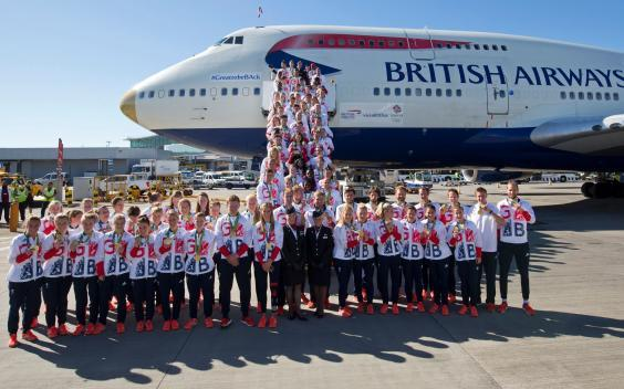 The British Olympic Team poses in front of a gold-tipped 747 (AFP via Getty)