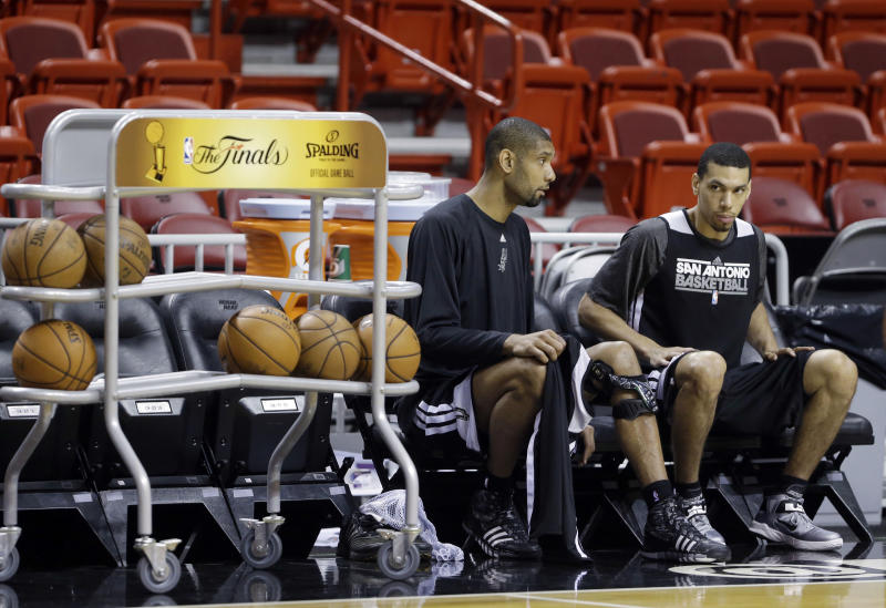 San Antonio Spurs shooting guard Danny Green, right, and power forward Tim Duncan chat as they prepare for NBA basketball practice, Wednesday, June 19, 2013, at the American Airlines Arena in Miami. The Spurs take on the Miami Heat in Game 7 of the NBA Finals on Thursday in Miami. (AP Photo/Wilfredo Lee)