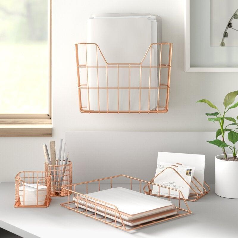 "<h2>Dotted Line Wire Metal 5-in-1 Desk Organizer Set</h2><br>The fastest and most affordable route to a clutter-free workspace. <br><br><em>Shop</em> <strong><em><a href=""https://www.wayfair.com/brand/bnd/dotted-line-b52372.html"" rel=""nofollow noopener"" target=""_blank"" data-ylk=""slk:Dotted Line"" class=""link rapid-noclick-resp"">Dotted Line</a></em></strong><br><br><strong>Dotted Line</strong> Wire Metal 5-in-1 Desk Organizer Set, $, available at <a href=""https://go.skimresources.com/?id=30283X879131&url=https%3A%2F%2Fwww.wayfair.com%2Ffurniture%2Fpdp%2Fdotted-line-amanda-wire-metal-5-in-1-desk-organizer-set-w000548064.html"" rel=""nofollow noopener"" target=""_blank"" data-ylk=""slk:Wayfair"" class=""link rapid-noclick-resp"">Wayfair</a>"