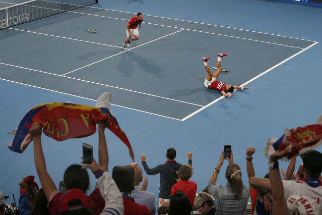 Novak Djokovic and Viktor Troicki of Serbia react during the tournament against Pablo Carreno Busta and Feliciano Lopez of Spain during their ATP Cup tennis match in Sydney, early Monday, Jan. 13, 2020. (AP Photo/Steve Christo)