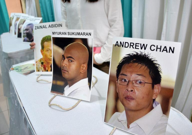 Photographs of executed drug convicts are displayed at a hospital morgue in Jakarta on April 29, 2015 during a prayer session