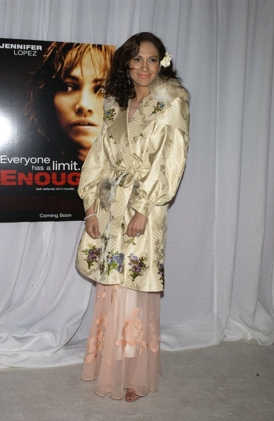 <p>Ah the coveted flower clip. Leave it to J.Lo to nail a trend. She wore this hair accessory with a coat that kiiiind of looks like an eclectic bathrobe to the premiere of <em>Enough </em>in New York City.</p>