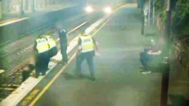 Shirtless Woman in the Path of Oncoming Train Rescued by Police in Pulse-Pounding Video