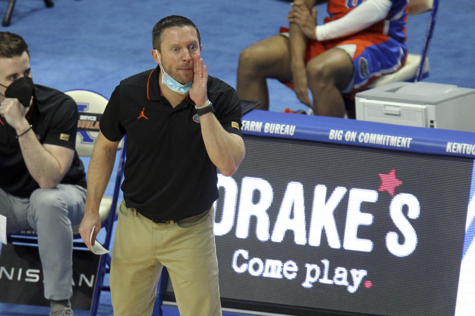 Florida head coach Mike White yells to his team during the first half of an NCAA college basketball game against Kentucky in Lexington, Ky., Saturday, Feb. 27, 2021. (AP Photo/James Crisp)