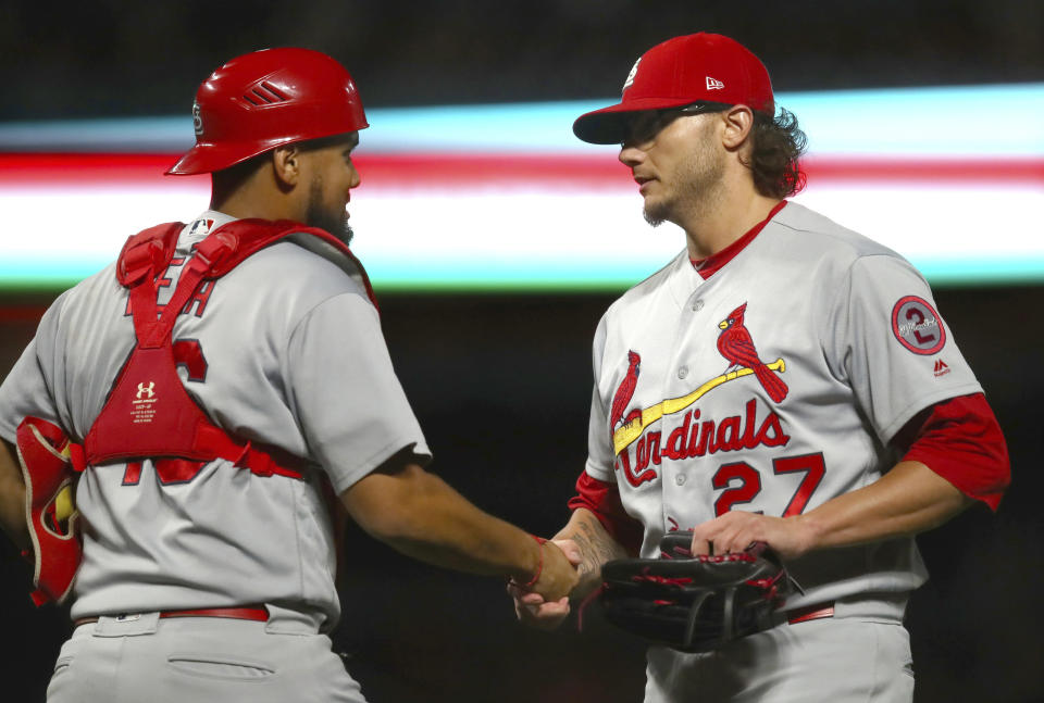 St. Louis Cardinals Yadier Molina, left, celebrates the team's 11-2 win over the San Francisco Giants with pitcher Brett Cecil (27) after a baseball game Thursday, July 5, 2018, in San Francisco. (AP Photo/Ben Margot)