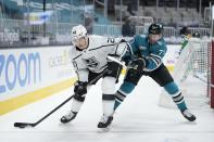 Los Angeles Kings right wing Dustin Brown (23) is defended by San Jose Sharks defenseman Nikolai Knyzhov (71) during the second period of an NHL hockey game Saturday, April 10, 2021, in San Jose, Calif. (AP Photo/Tony Avelar)