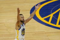 Golden State Warriors guard Stephen Curry (30) gestures after shooting a 3-point basket against the Memphis Grizzlies during the second half of an NBA basketball game in San Francisco, Sunday, May 16, 2021. (AP Photo/Jeff Chiu)