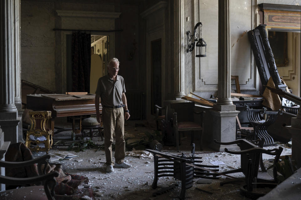 """Roderick Sursock stands in a heavily damaged room of the Sursock Palace, affected by the explosion in the seaport of Beirut, Lebanon, Saturday, Aug. 8, 2020. """"In a split second, everything was destroyed again,"""" said Sursock, owner of the charming Sursock Palace, one of the most prominent and well-known buildings in the Lebanese capital. (AP Photo/Felipe Dana)"""