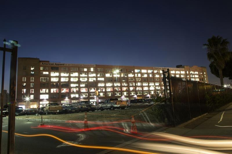Automobile light streaks are pictured at the American Apparel factory headquarters in Los Angeles, California