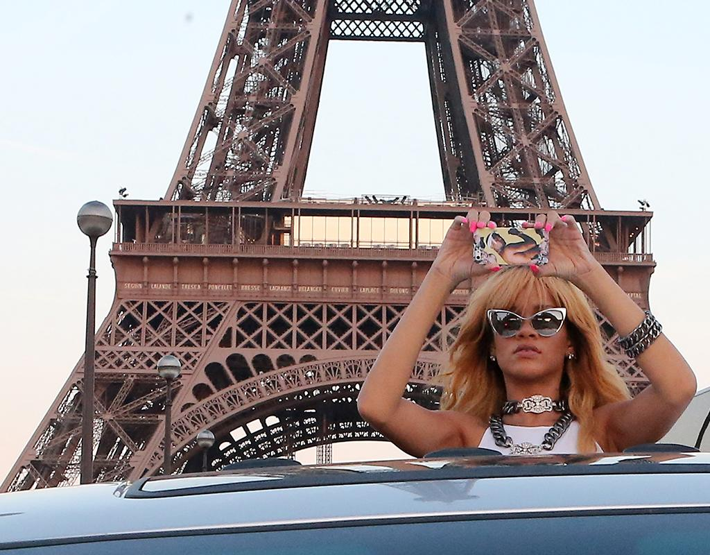 51123301 Singer Rihanna and her friends snap some fun pictures in front of the Eiffel Tower in Paris, France on June 7, 2013. FameFlynet, Inc - Beverly Hills, CA, USA -  1 (818) 307-4813 RESTRICTIONS APPLY: USA ONLY