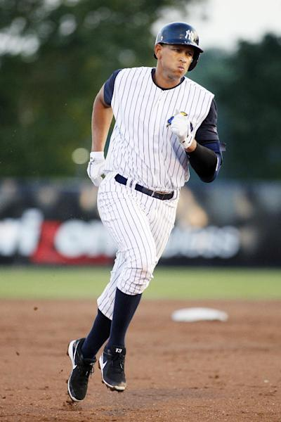 New York Yankees' Alex Rodriguez runs the bases after hitting a solo home run during the third inning of a Class AA baseball game with the Trenton Thunder against the Reading Phillies, Friday, Aug. 2, 2013, in Trenton, N.J. (AP Photo/Tom Mihalek)
