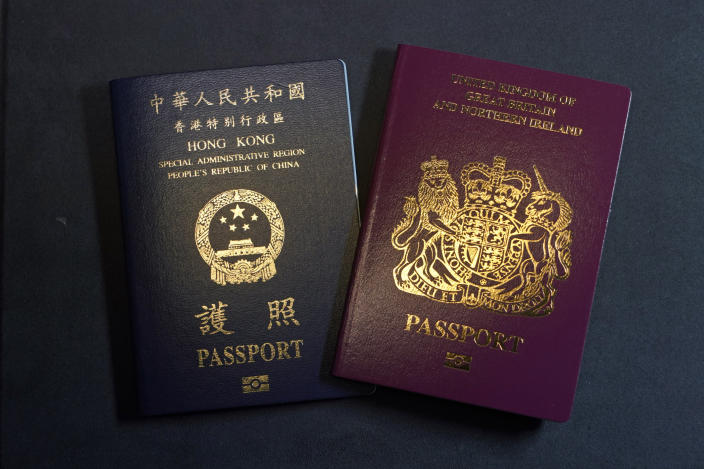 A British National Overseas passports (BNO) and a Hong Kong Special Administrative Region of the People's Republic of China passport are pictured in Hong Kong, Friday, Jan. 29, 2021. China said Friday it will no longer recognize the British National Overseas passport as a valid travel document or form of identification amid a bitter feud with London over a plan to allow millions of Hong Kong residents a route to residency and eventual citizenship. (AP Photo/Kin Cheung)
