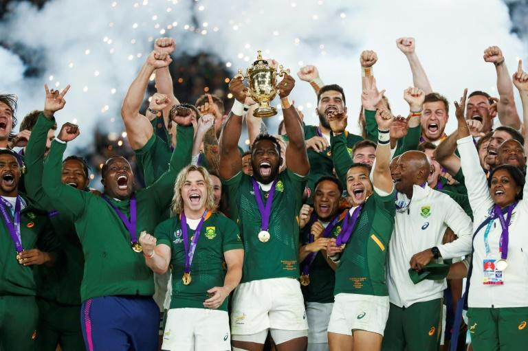South Africa's captain Siya Kolisi lifts the Webb Ellis Cup after his side won the Rugby World Cup final against England a year ago in Japan