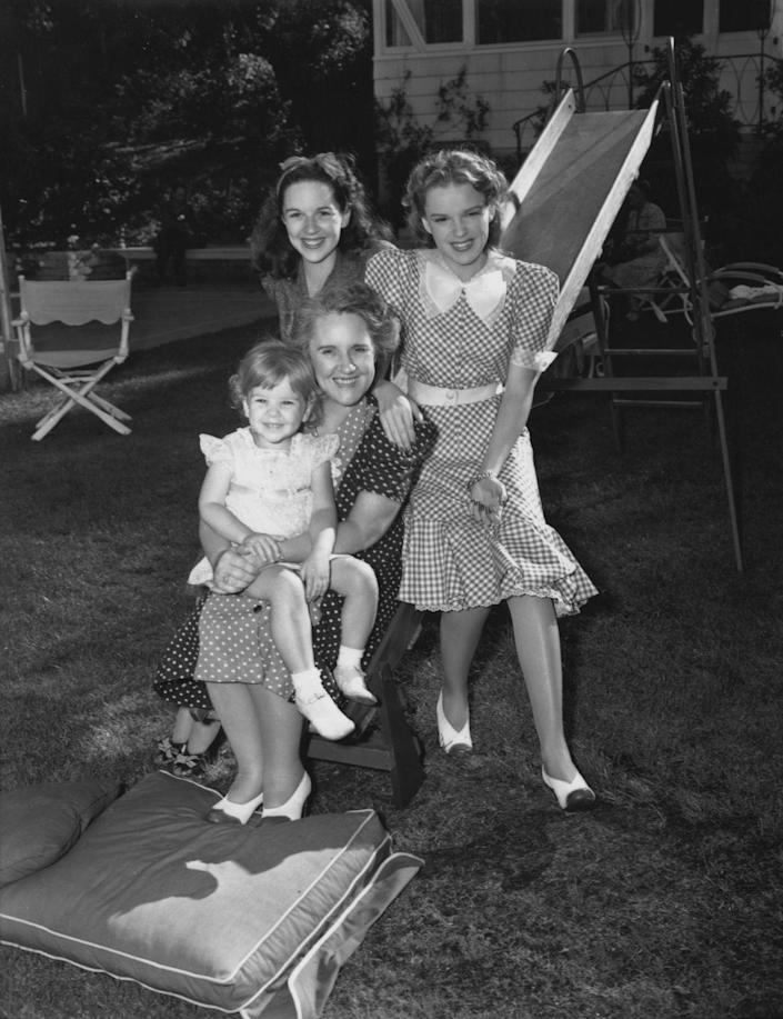 <p>Judy posed here with her mom, sister, and niece in this casual family portrait. </p>