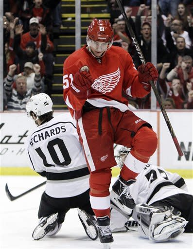Detroit Red Wings center Valtteri Filppula (51), of Finland, reacts after scoring the tying goal against Los Angeles Kings goalie Jonathan Quick, right, during the third period of an NHL hockey game in Detroit, Friday, March 9, 2012. Detroit won 4-3. (AP Photo/Carlos Osorio)