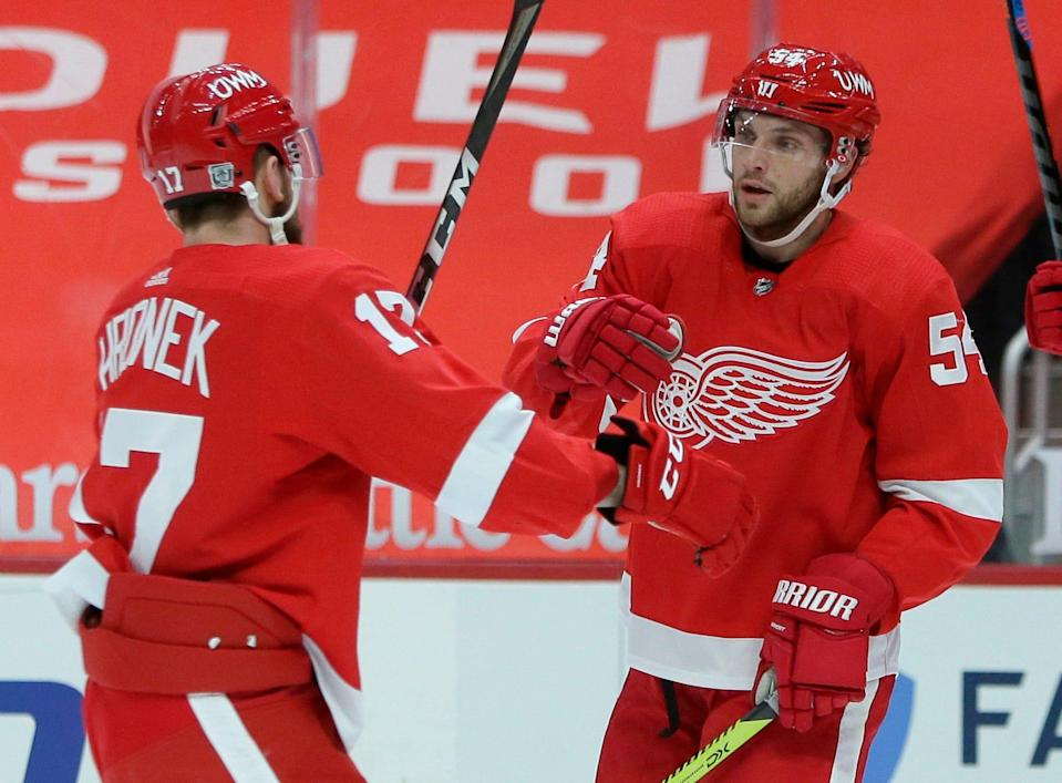 Detroit Red Wings defenseman Filip Hronek (17) celebrates with right wing Bobby Ryan (54) after a goal by Anthony Mantha during the second period of the team's NHL hockey game against the Columbus Blue Jackets on Tuesday, Jan. 19, 2021, in Detroit. Ryan also scored in the team's 3-2 overtime win.