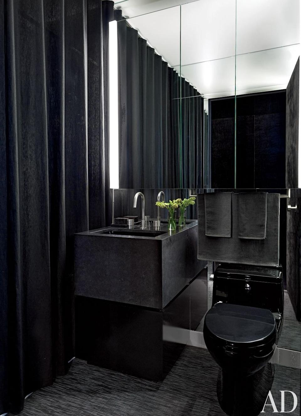 In Gilles Mendel's Manhattan apartment, the bath's vanity is granite and the black towels are by Calvin Klein Home.