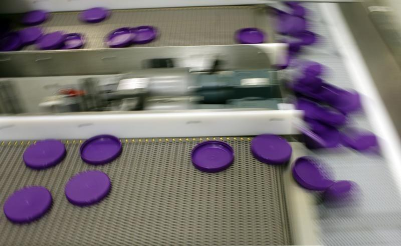 Plastic lids are manufactured at the Berry Plastic Corp. factory in Evansville