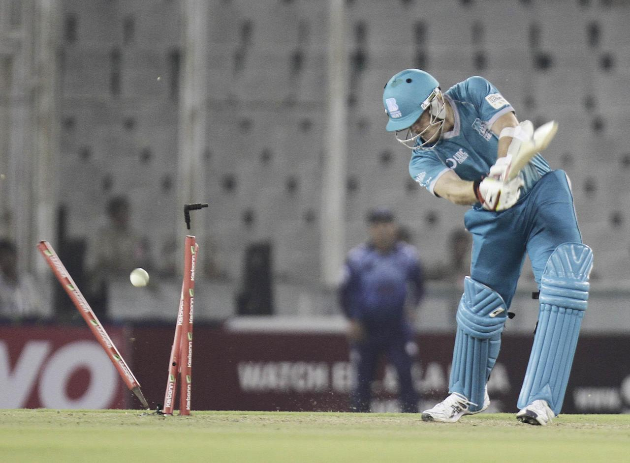 C D Hartley walks off after getting bowled during the Champions League T20, 6th match, Group B, between Brisbane Heat and Titans at Mohali stadium, Chandigarh  on Sept. 24, 2013. (Photo: IANS)