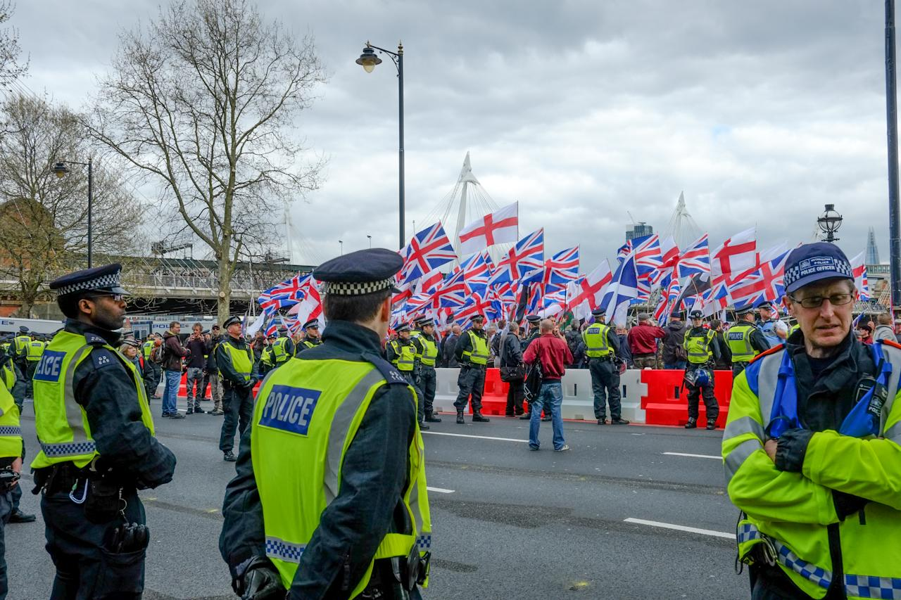 Protesters hold placards and British Union Jack flags during a protest titled 'London march against terrorism' in response to the March 22 Westminster terror attack on April 1, 2017 in London, England. The march has been organised by far-right groups English Defence League and Britain First, which also sees a counter-protest held by group 'Unite Against Fascism'. During the terror attack in Westminster, Khalid Masood killed 4 people as he drove a car into pedestrians over Westminster Bridge and stabbed PC Keith Palmer to death before being shot dead himself.  (Photo by Jay Shaw Baker/NurPhoto via Getty Images)
