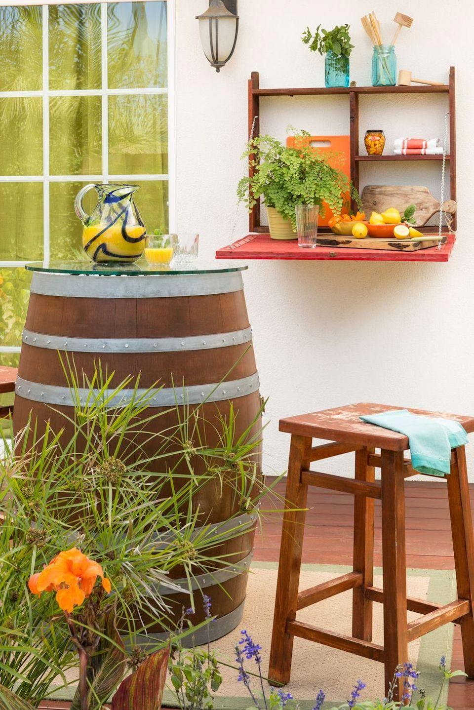 <p>Mount a folding shelf to the exterior of your house, and use it to hold party snacks, drinks, or even decorative accents. </p>