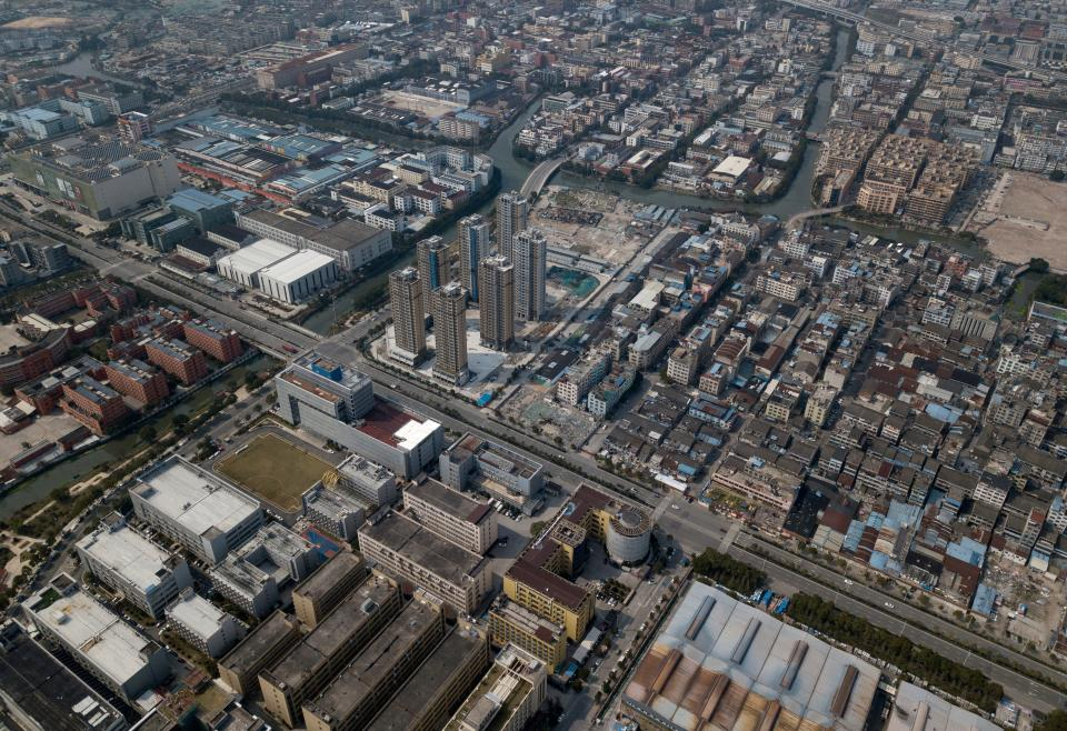 This aerial photo taken on February 28, 2020, shows factory and residential compounds in Wenzhou. - The coronavirus outbreak in China is preventing clothing manufacturer Ugly Duck Industry from resuming its normal production of winter coats, so it has pivoted to another in-demand product: hazmat suits. (Photo by NOEL CELIS / AFP) / TO GO WITH AFP STORY HEALTH-VIRUS-CHINA-HAZMAT-FACTORY,SCENE BY DAN MARTIN (Photo by NOEL CELIS/AFP via Getty Images)