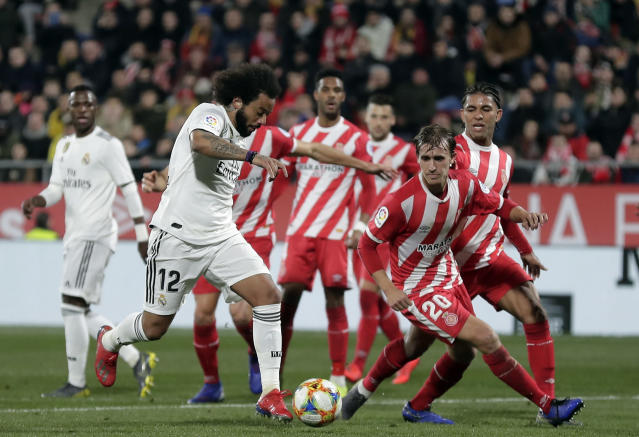 Real Madrid's Marcelo, center left, runs with the ball during a Spanish Copa del Rey soccer match between Girona and Real Madrid at the Montilivi stadium in Girona, Spain, Thursday, Jan. 31, 2019. (AP Photo/Manu Fernandez)