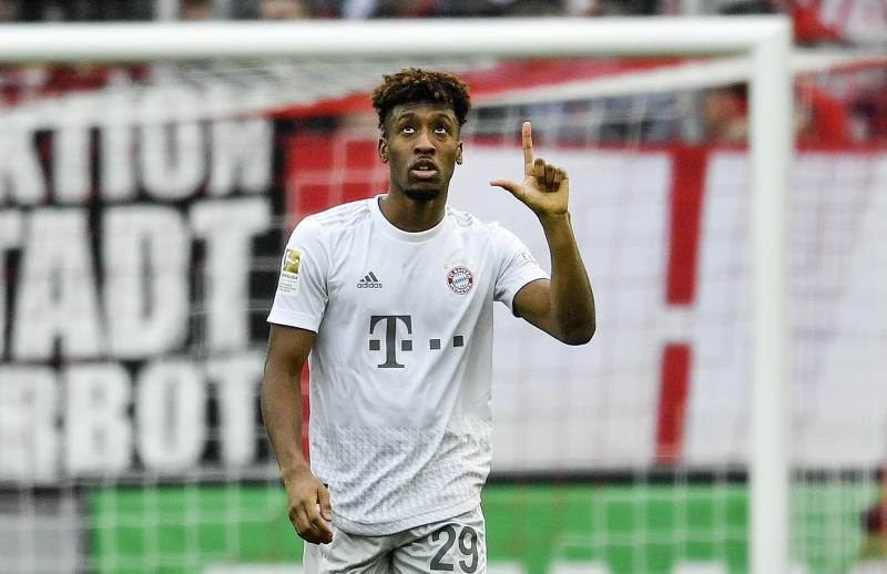Bayern's Kingsley Coman reacts after he scored Bayern's 2nd goal during the German Bundesliga soccer match between 1. FC Cologne and Bayern Munich in Cologne, Germany, Sunday, Feb. 16, 2020. (AP Photo/Martin Meissner)