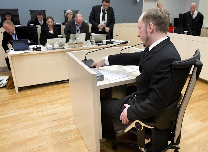 Defendant Anders Behring Breivik, foreground, seen during the fourth day of proceedings in the courthouse in Oslo, Norway, Thursday April 19, 2012. Confessed mass killer Anders Behring Breivik testified Thursday that he had planned to capture and decapitate former Norwegian Prime Minister Gro Harlem Brundtland during his shooting massacre on Utoya island. (AP Photo / Heiko Junge)