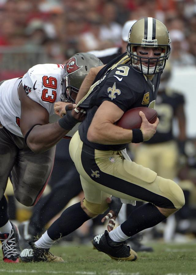 New Orleans Saints quarterback Drew Brees (9) is sacked by Tampa Bay Buccaneers defensive tackle Gerald McCoy (93) during the first quarter of an NFL football game on Sunday, Sept. 15, 2013, in Tampa, Fla. (AP Photo/Phelan M. Ebenhack)