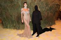 <ul> <li><strong>What to wear for Kendall: </strong>To pull off Kendall's Met Gala look, wear a sheer jeweled dress with a sparkly choker.</li> <li><strong>What to wear for Kim: </strong>To channel Kim's anonymous black Balenciaga look, dress in all black from head to toe. Try wearing a ski mask or panty hose to cover your face, and don't forget to wear a black cape! </li> </ul>