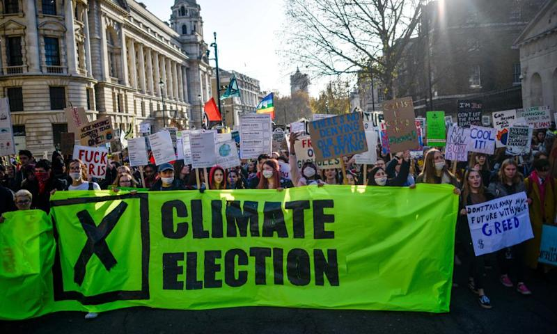 """Students march in a """"Fridays for Future"""" climate strike on 29 November in London."""