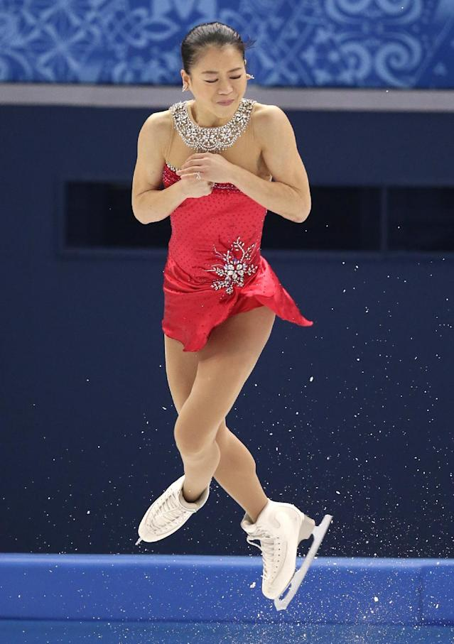 Akiko Suzuki of Japan competes in the women's short program figure skating competition at the Iceberg Skating Palace during the 2014 Winter Olympics, Wednesday, Feb. 19, 2014, in Sochi, Russia. (AP Photo/Bernat Armangue)