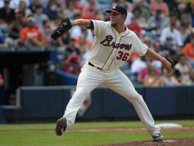 Atlanta Braves starting pitcher Mike Minor delivers to the San Francisco Giants during the third inning of their baseball game at Turner Field, Saturday, June 15, 2013, in Atlanta. (AP Photo/David Tulis)