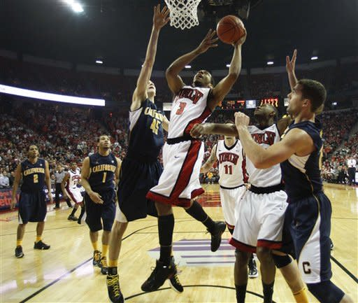 UNLV's Anthony Marshall (3) puts up a shot against California's David Kravish (45) in the first half of an NCAA college basketball game, Friday, Dec. 23, 2011, in Las Vegas. (AP Photo/Julie Jacobson)