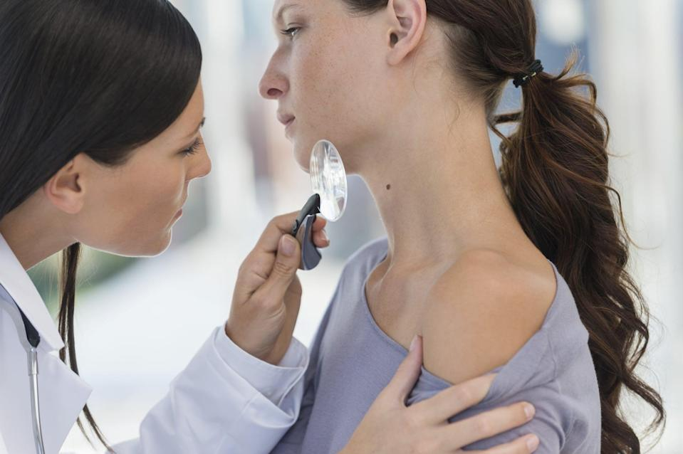 """<p>Right up there with wearing sunscreen daily is getting regular skin checks for skin cancer. """"It is so important that people start getting annual skin cancer screenings in their 20s to help catch and detect skin cancer,"""" board-certified dermatologist <a href=""""https://www.optiskinmedical.com/"""" class=""""link rapid-noclick-resp"""" rel=""""nofollow noopener"""" target=""""_blank"""" data-ylk=""""slk:Orit Markowitz"""">Orit Markowitz</a>, MD, said. """"Early detection is crucial to treating skin cancer before it becomes melanoma."""" </p> <p>If you're prone to moles or have a history of skin cancer, Dr. Markowitz actually recommended going biannual and ensuring your doctor uses a dermatoscope. """"This is a hand-held microscope that has double the magnification and uses polarized lighting that allows us to look at your skin with more clarity,"""" she said. """"Currently, only 50 percent of dermatologists use this, and without utilizing this tool, you really are not getting a proper skin screening.""""</p>"""