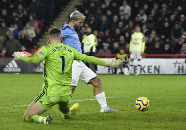Manchester City's Sergio Aguero scores his side's opening goal during the English Premier League soccer match between Sheffield United and Manchester City at Bramall Lane in Sheffield, England, Tuesday, Jan. 21, 2020. (AP Photo/Rui Vieira)