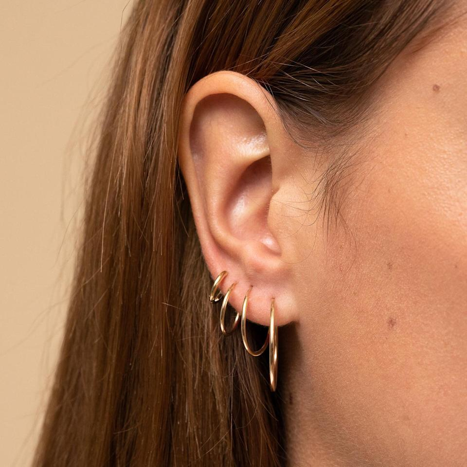"""Gold hoops are kind of my staple, I always have a pair in. So I'm always on the hunt for a lighter, shinier and more secure pair (RIP to all the pairs I've lost and the graveyard of lonely hoops in my jewelry box). I've been eyeing these <a href=""""https://fave.co/3fxQosC"""" target=""""_blank"""" rel=""""noopener noreferrer"""">Mejuri Large Hoops</a> for a while and think they'll make a nice holiday gift for myself, especially since they're offering up to 20% off. -<strong>Gonzalez</strong>"""