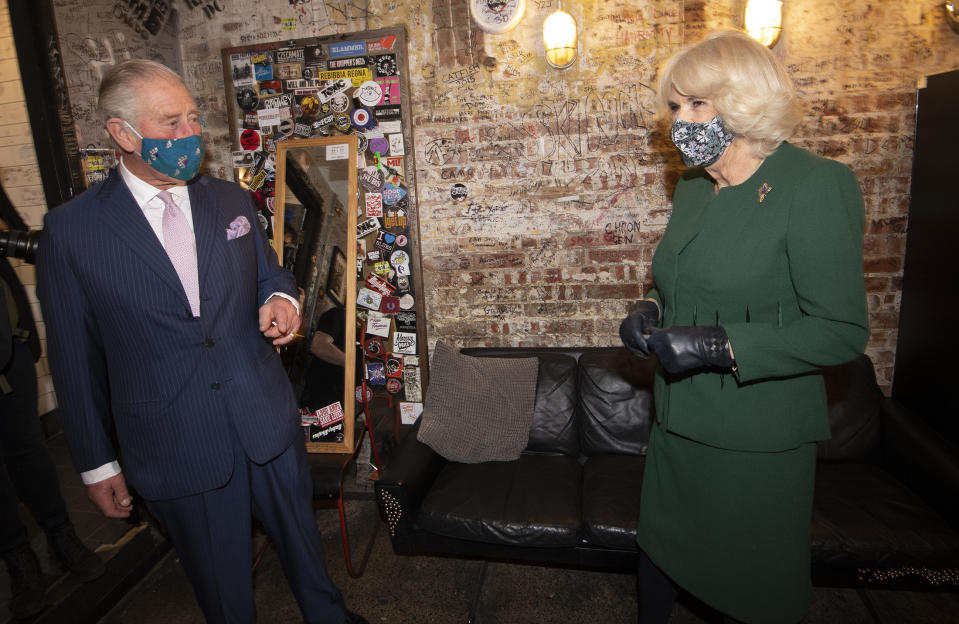 LONDON, ENGLAND - DECEMBER 03: Camilla, Duchess of Cornwall and Prince Charles, Prince of Wales arrive at nightclub during a visit to celebrate London's night economy on December 3, 2020 in London, England. Their Royal Highnesses will be presented to the club's owner and Manager, Mr. Jeff Horton and co-manager, Ms. Ruby Horton. The Prince and The Duchess will meet music and industry professionals, before watching a short musical performance by singer Emily Capell. (Photo by Eddie Mulholland-WPA Pool/Getty Images)