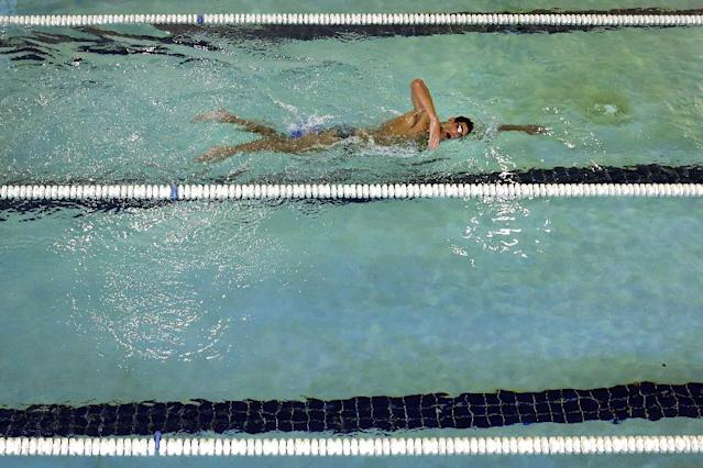 In this July 31, 2014 photo, Michael Phelps swims at Meadowbrook Aquatic and Fitness Center in Baltimore. This is where Phelps put in most of the work to become the most decorated athlete in Olympic history. This is where he's looking to add to that legacy after an aborted retirement, his eyes firmly on the Rio Games two years away. (AP Photo/Patrick Semansky)