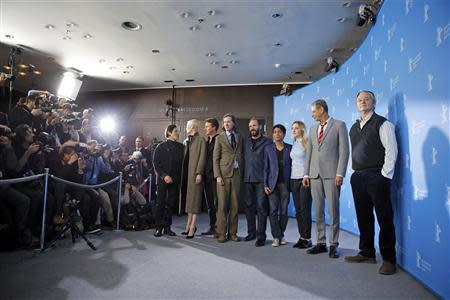 """Actors Willem Dafoe, Tilda Swinton, Edward Norton, director Wes Anderson, Ralph Fiennes, Tony Revolori, Saoirse Ronan, Jeff Goldblum and Bill Murray (L-R) pose to promote the movie """"The Grand Budapest Hotel"""" at the 64th Berlinale International Film Festival in Berlin February 6, 2014. REUTERS/Thomas Peter"""