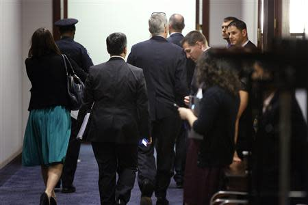 White House Chief of Staff Denis McDonough (C, with his glasses atop his head) departs after meeting with House Democrats about proposed U.S. military action against Syria, at the U.S. Capitol in Washington, September 10, 2013. REUTERS/Jonathan Ernst