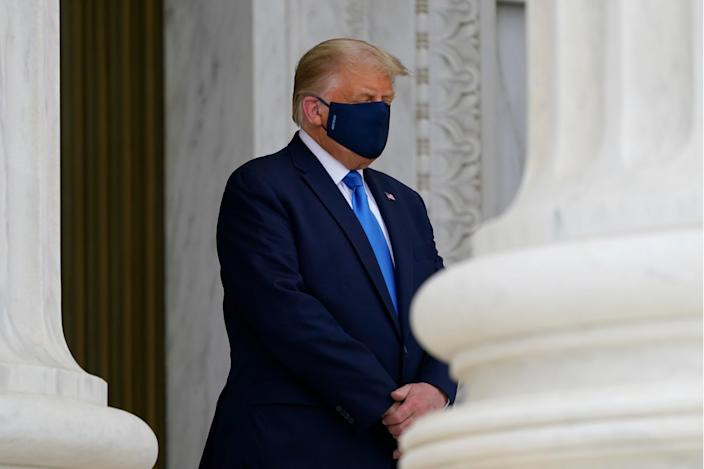 President Donald Trump, left, pays respects as Justice Ruth Bader Ginsburg lies in repose under the Portico at the top of the front steps of the U.S. Supreme Court building on Thursday, Sept. 24 2020.
