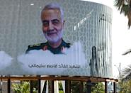 "A billboard in Baghdad in February 2020 mourns top Iranian general Qasem Soleimani, calling him a ""martyr,"" after he was killed in a US drone attack in the Iraqi capital (AFP Photo/AHMAD AL-RUBAYE)"